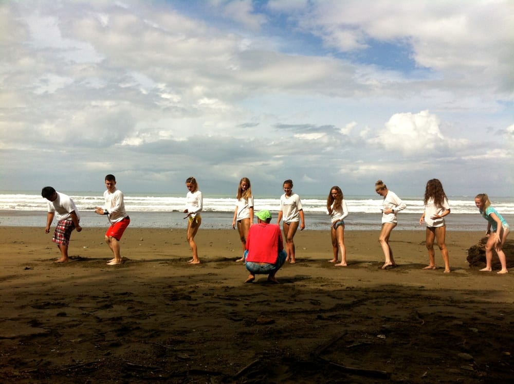 High school students surfing in Costa Rica